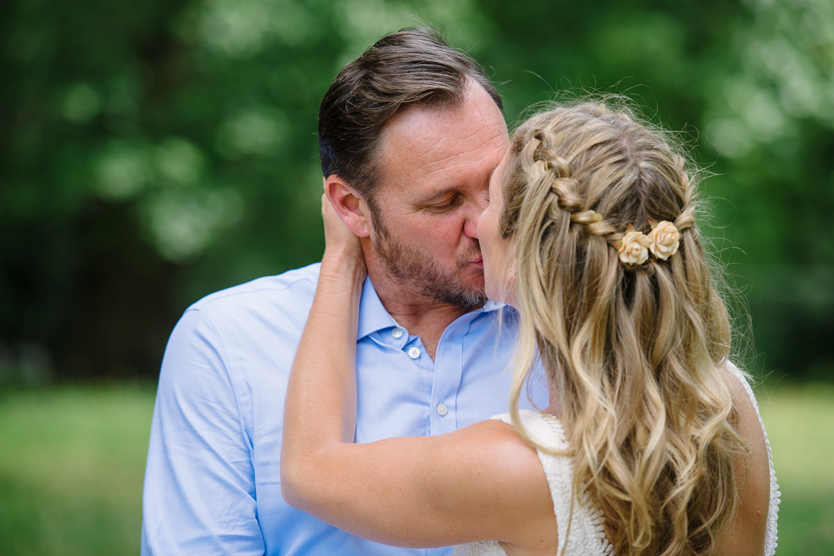 Bride and groom kissing - bridal hair inspiration