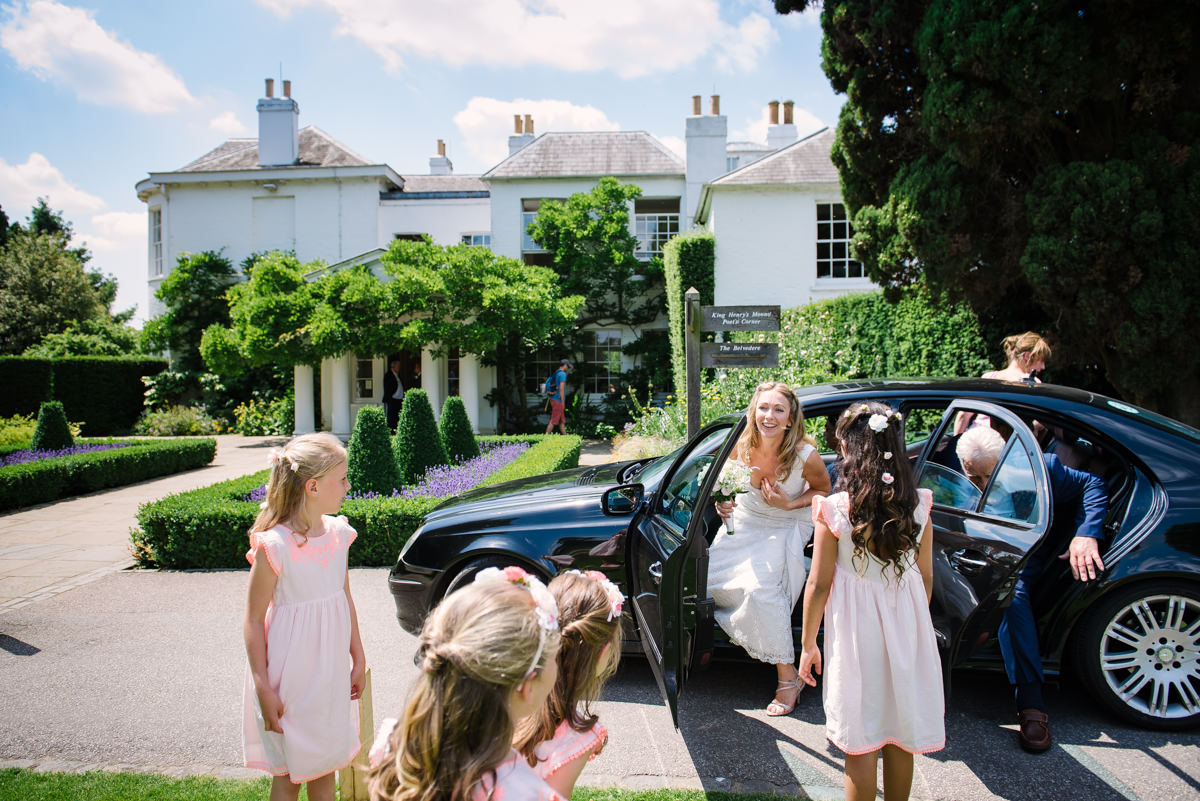 Bride and father arrive at Pembroke Lodge in Richmond
