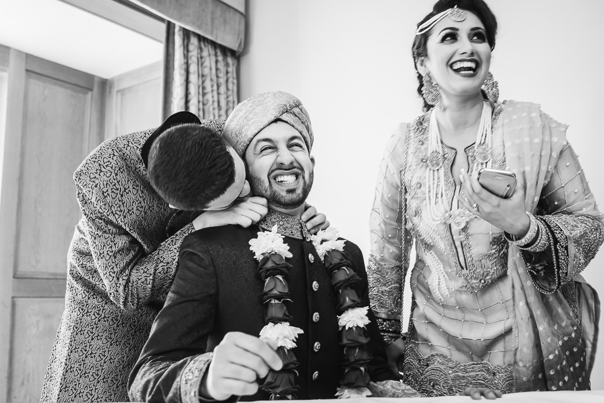 Asian wedding photography at Alton House Hotel - siblings playing