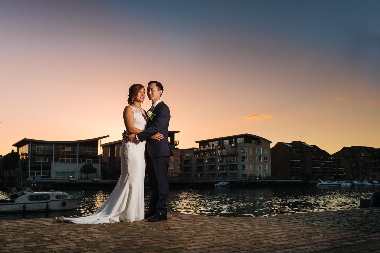 Wedding couple portrait by the Thames in Kingston