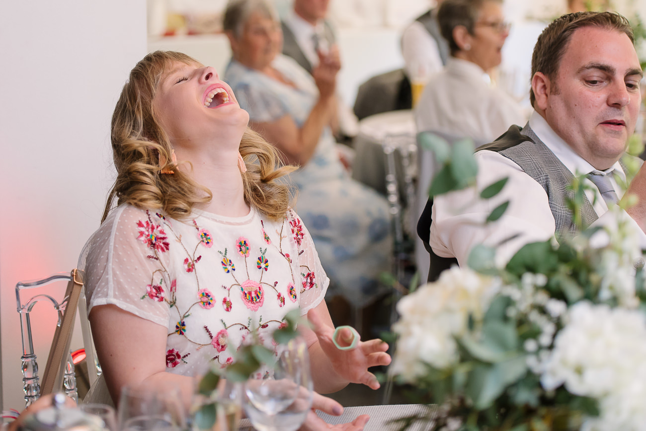 Wedding guest laughing and having good time at Russets Country House