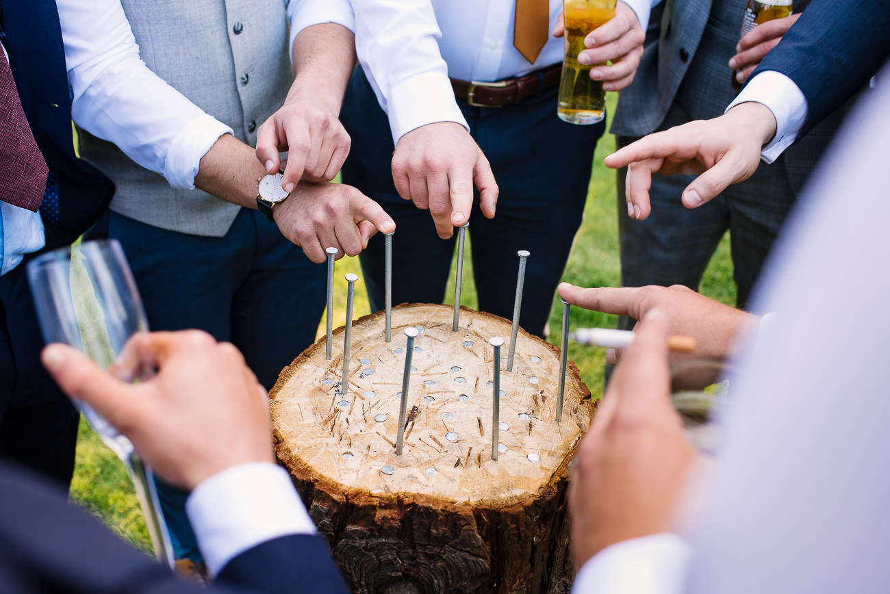 Wedding guest hands playing stump drinking game at Russets Country House