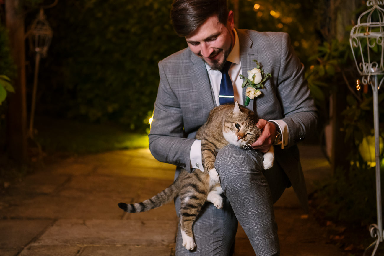 Groom petting the cat at Russets Country House
