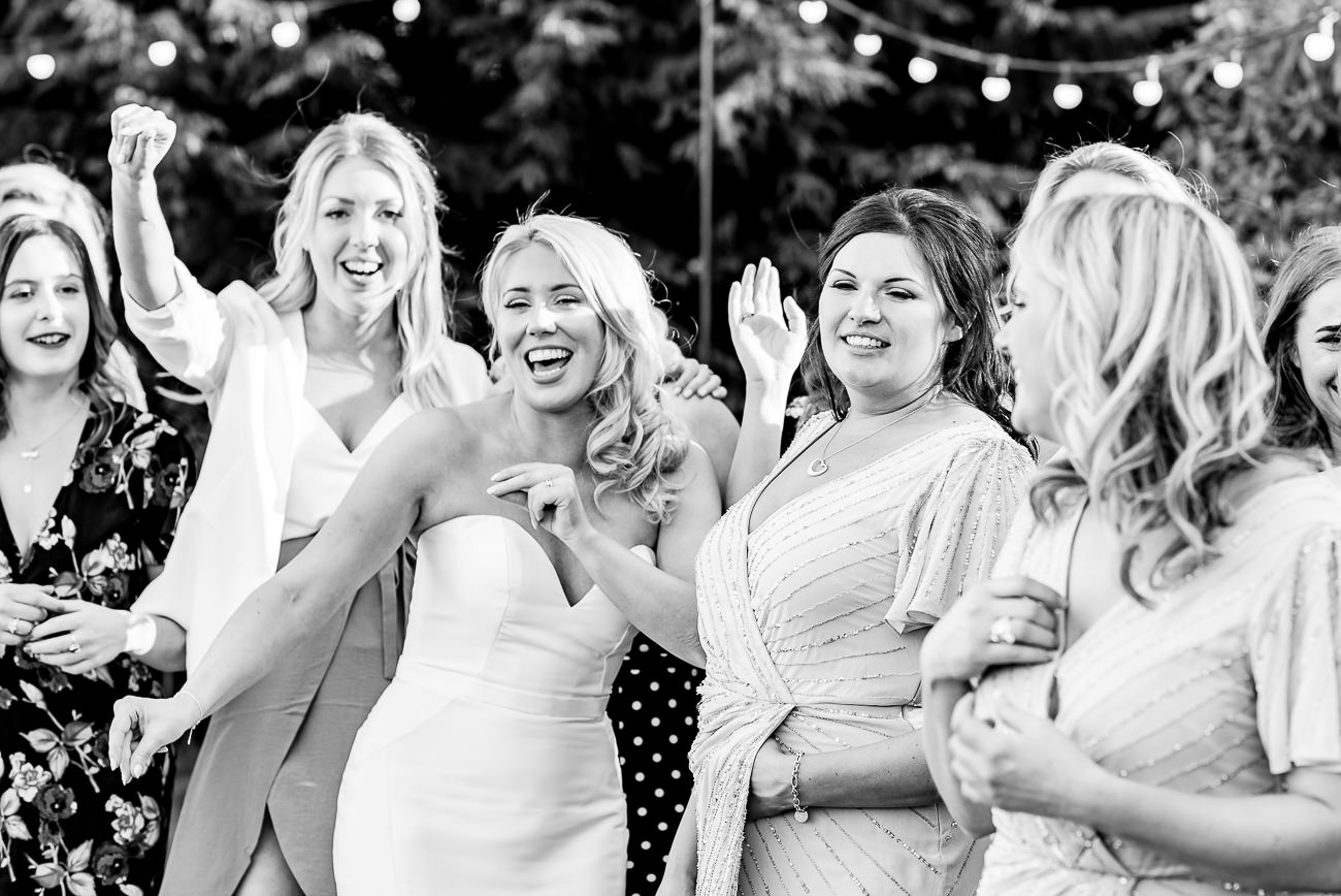 Bride along with bridesmaids taking a group photo at Russets