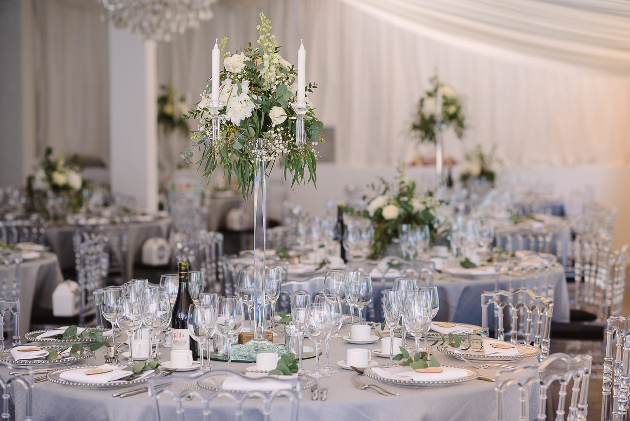 Table set up with white flowers and grey table cloth at Russets Country House