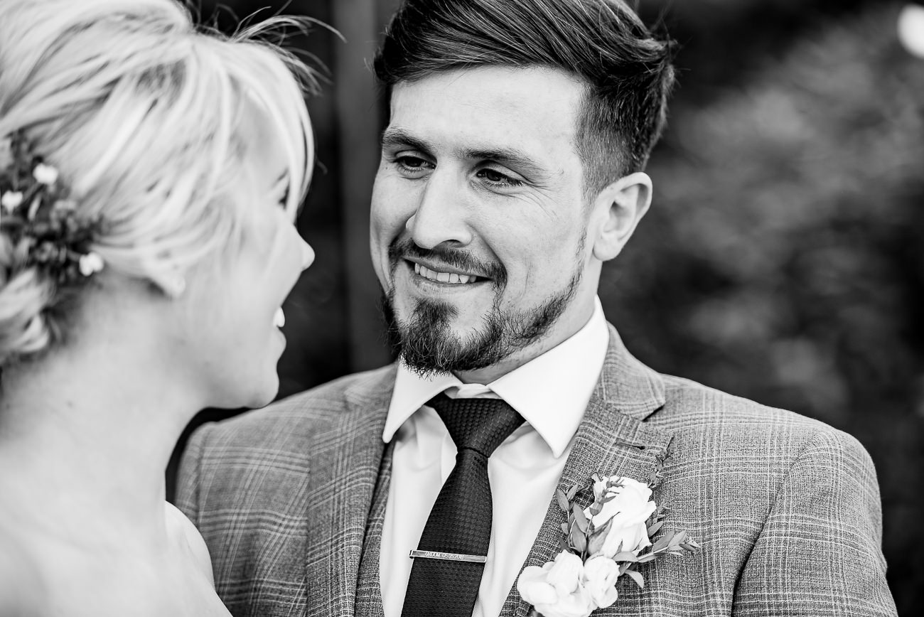 Groom lovingly looking at his bride portrait at Russets Country House