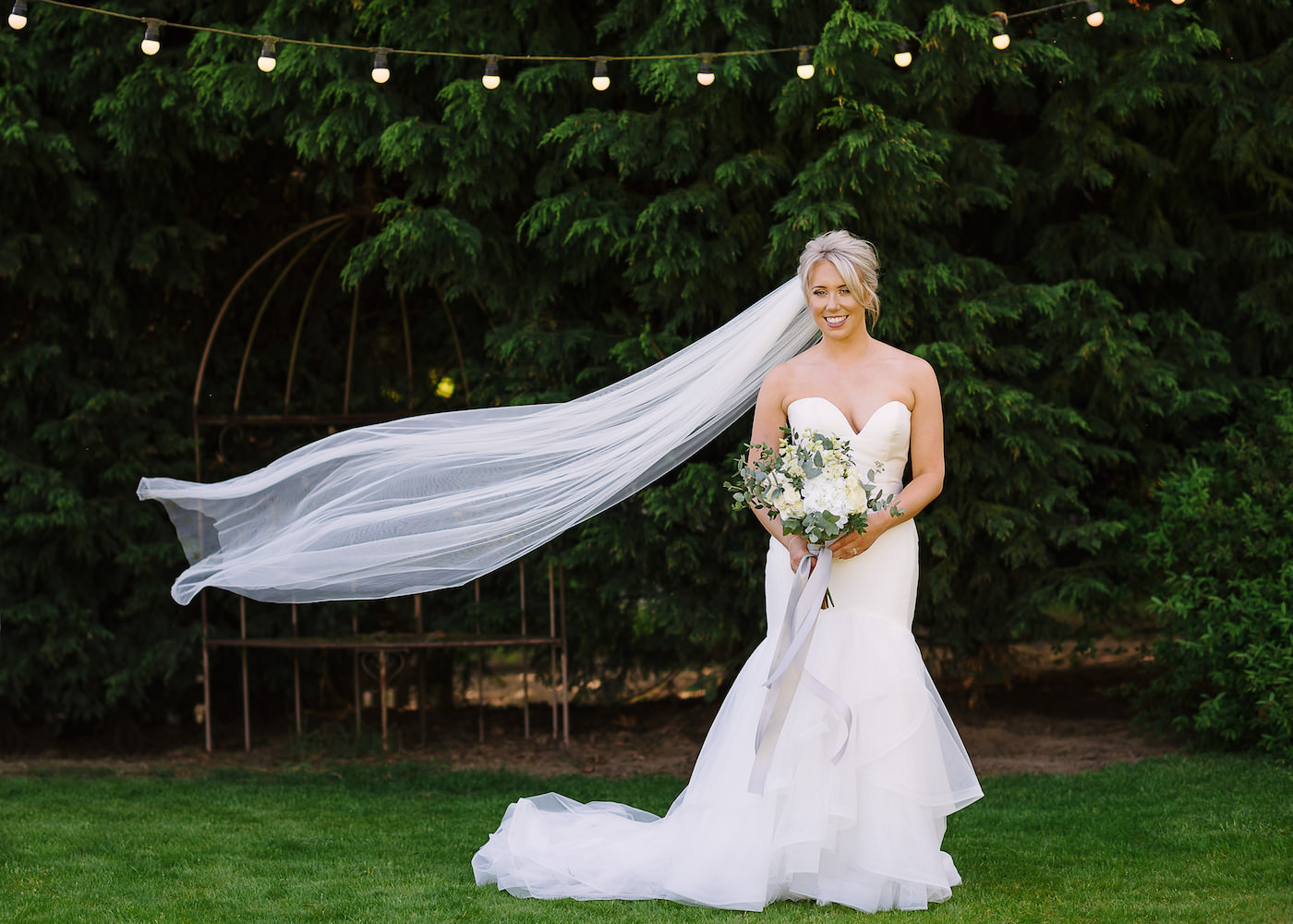 Bride's long white veil lifted by wind at Russets Country House