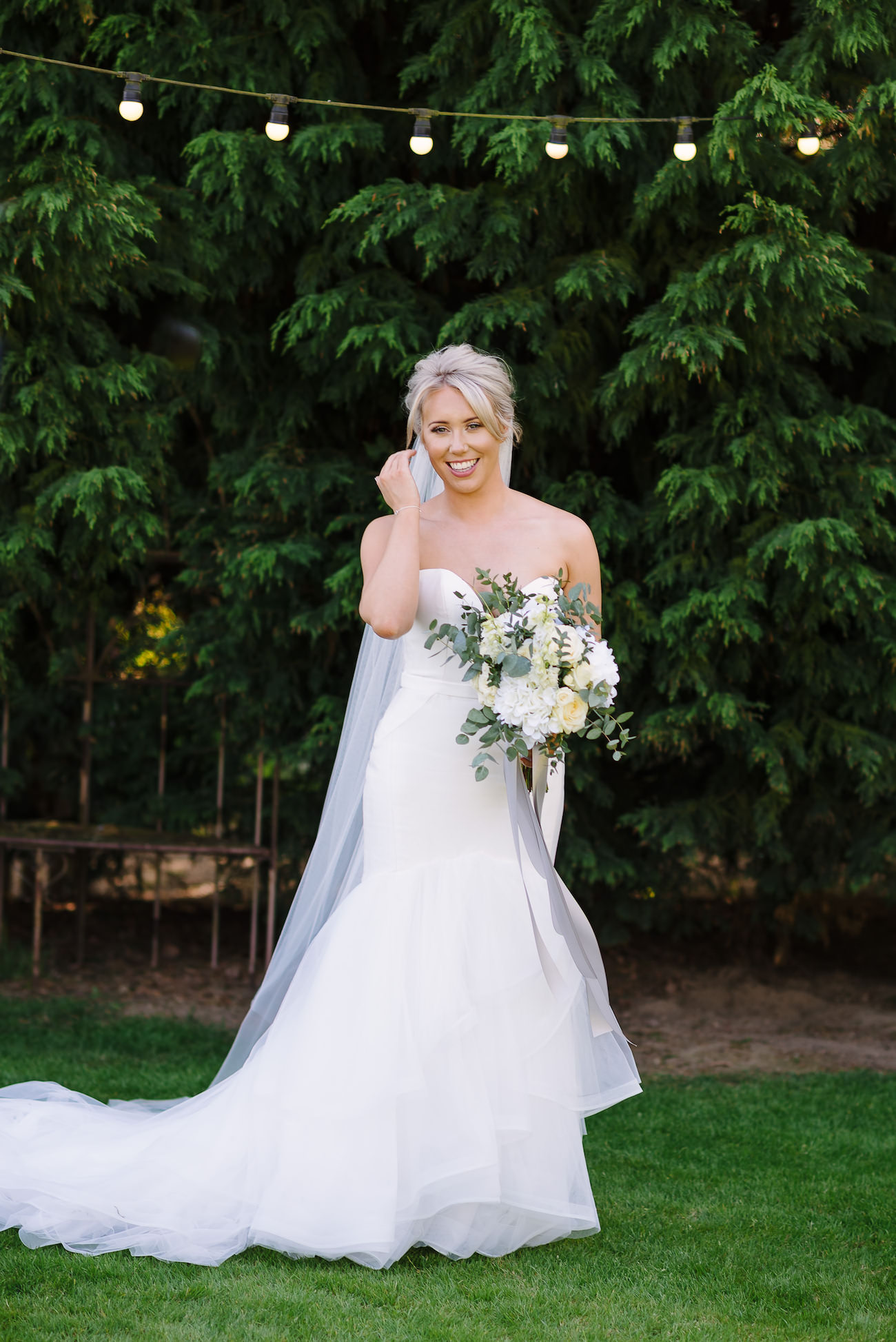 Bridal portrait with white flowers bouquet at Russets Country House