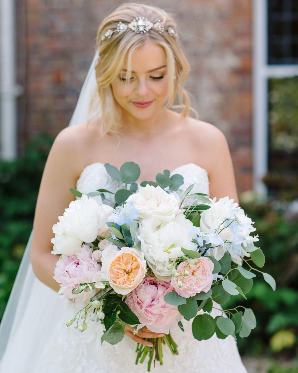 David Austin roses, peonies & blue delphinium bridal bouquet.