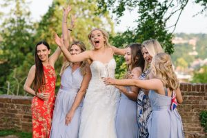 Blonde bride & her best girlfriends having fun taking photographs in the grounds of Farnham Castle