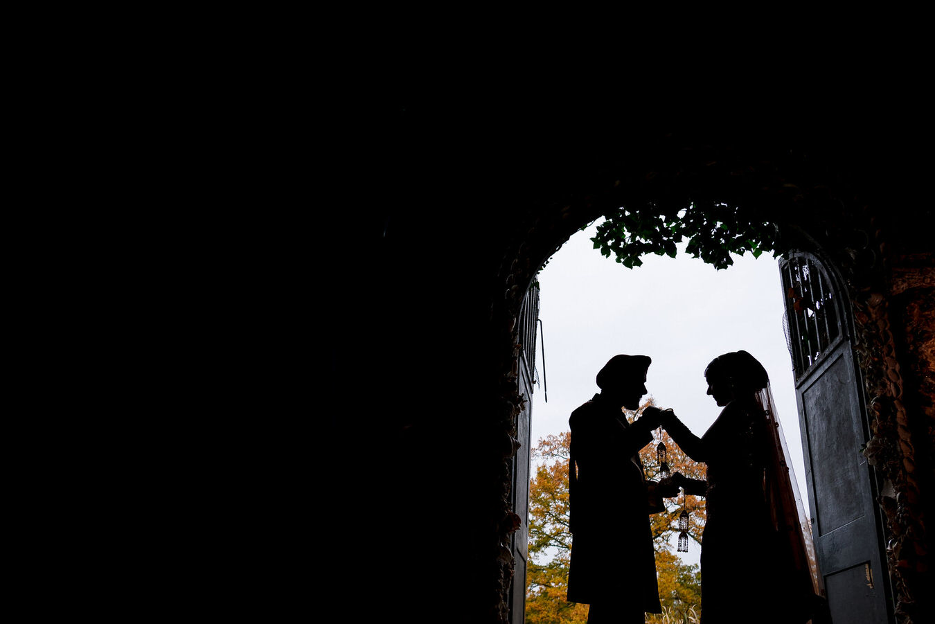 Asian bride and groom silhouette photograph.