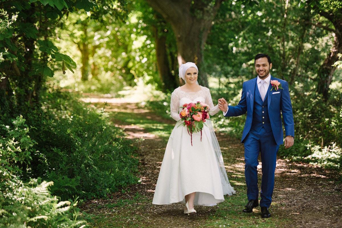 Woodland walk bride and groom portrait | wedding photography at Tournerbury Woods Estate