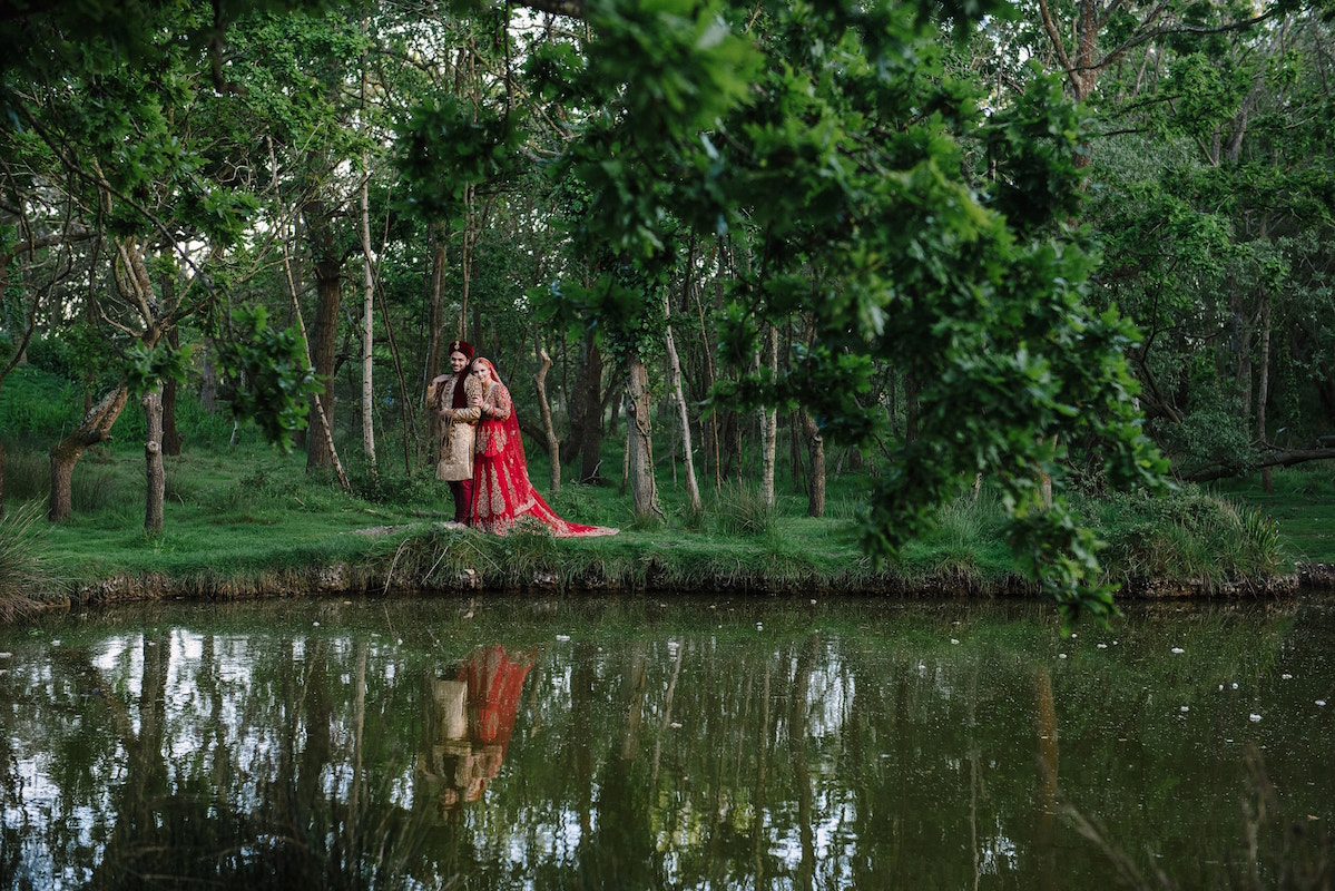 Natural woodland bride and groom portrait at an asian wedding