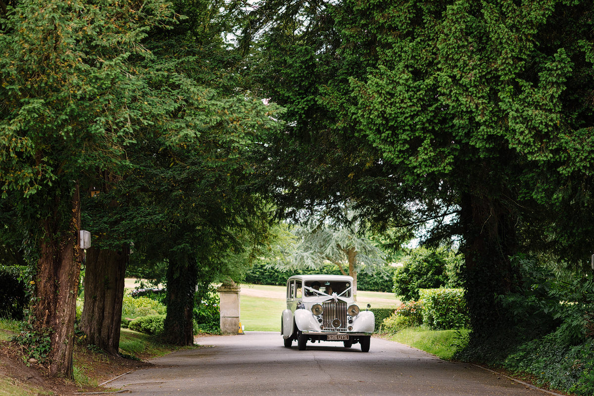 Wedding car arriving at Canford Parish Church