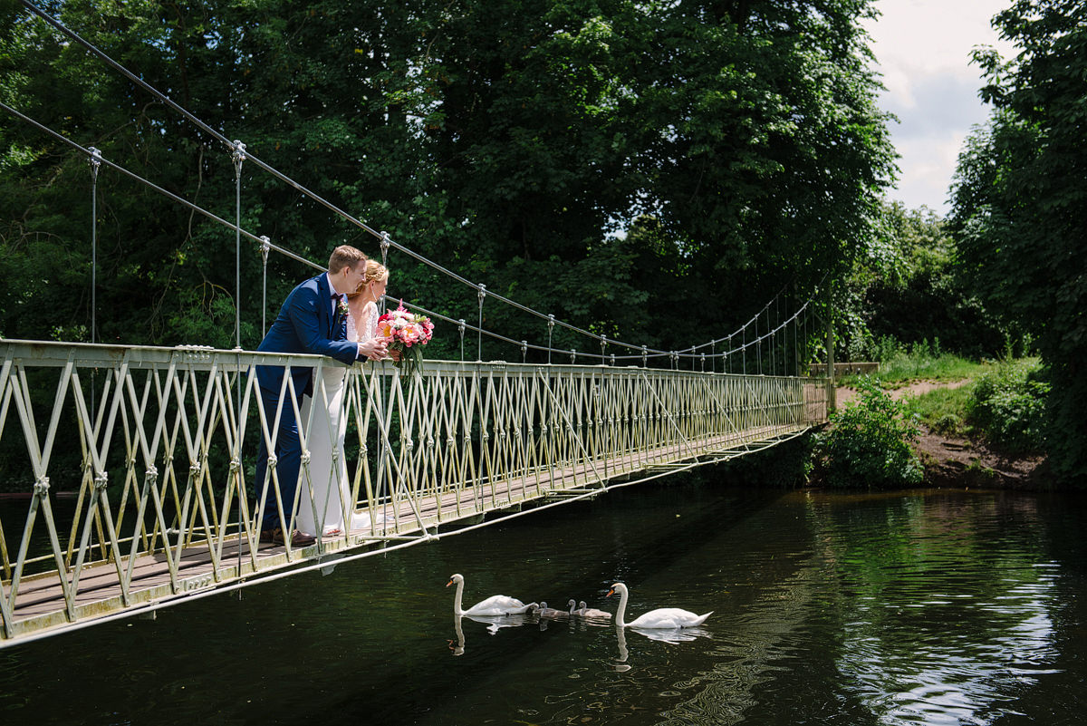 Wedding portrait on the bridge at Canford Parish Church