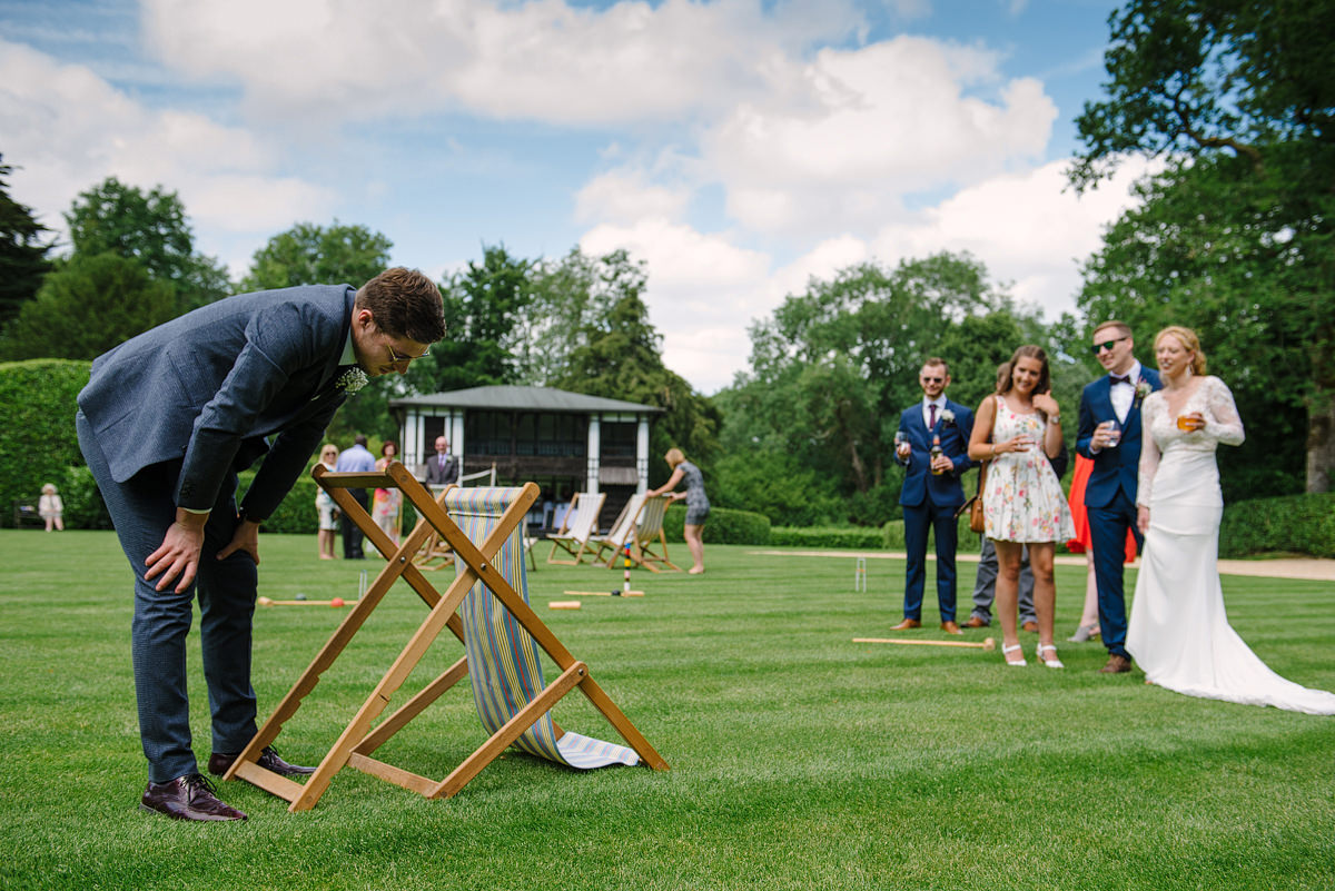 Wedding couple and guest on the lawn at Larmer Tree