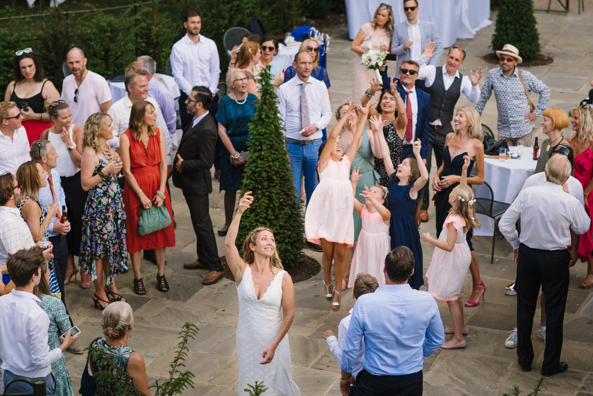 Bride throws her bouquet
