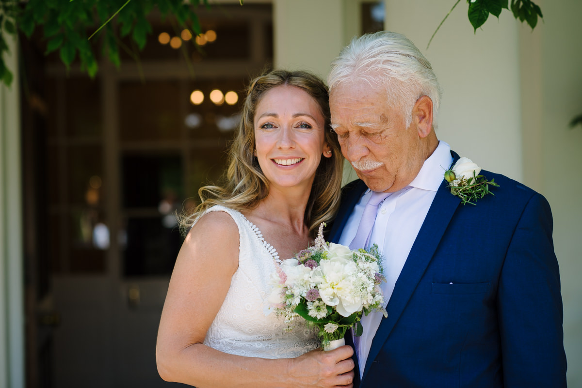 Bride and father moment before wedding ceremony
