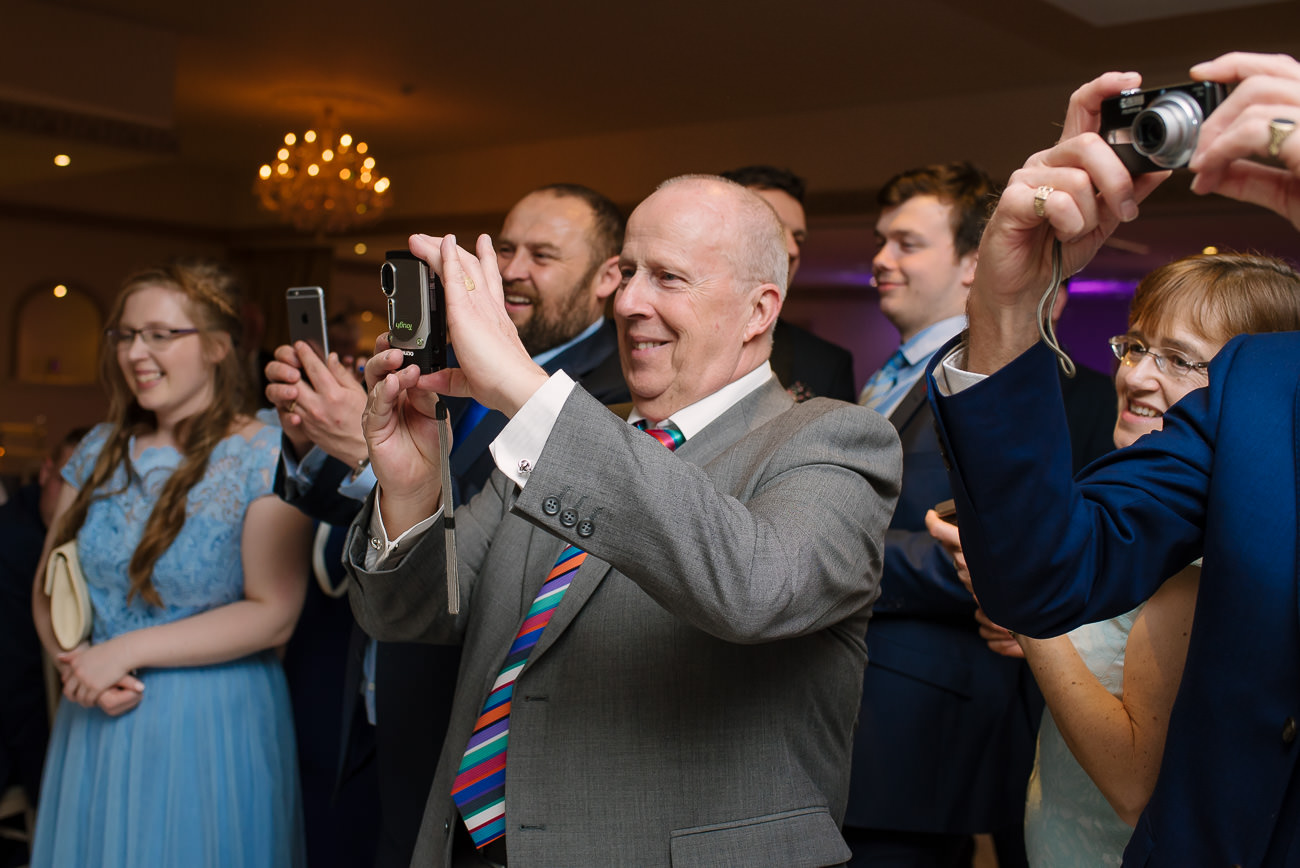 People photographing the young couple - first dance wedding photography at Froyle Park
