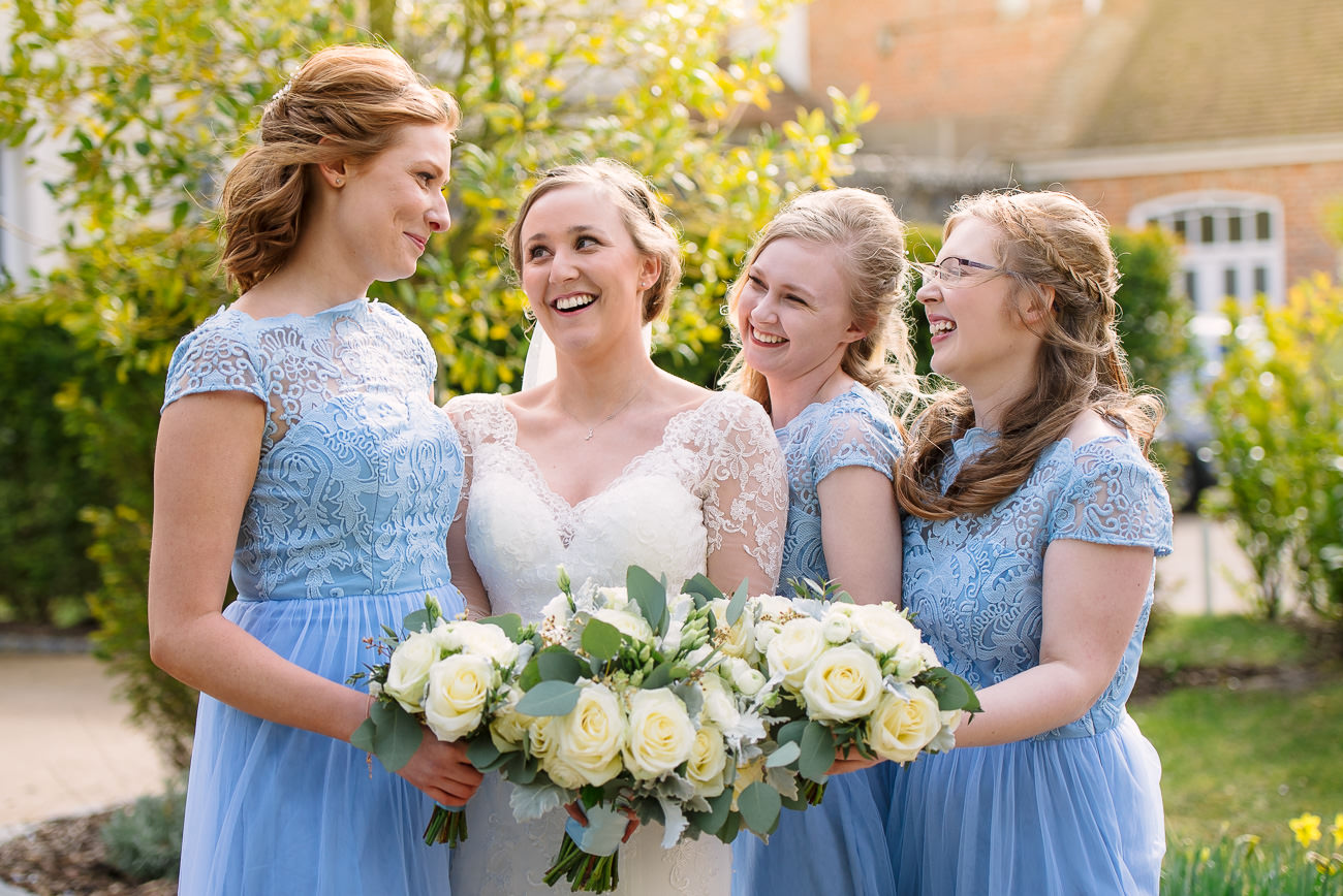 Wedding Photography Bridesmaids having fun - flower bouquets by Fiona Curry at Froyle Park