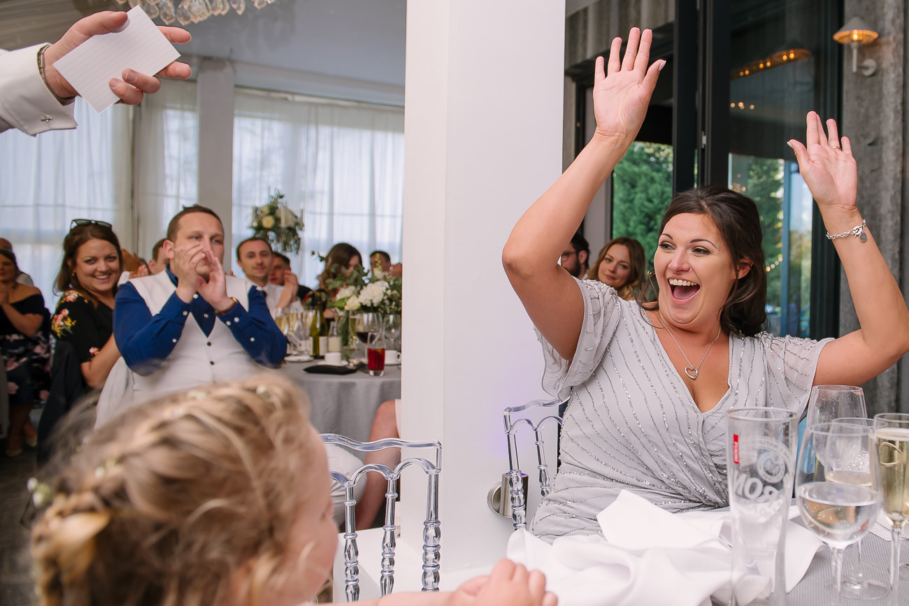 Bridesmaid joyful with hands raised up in the air at Russets Country House
