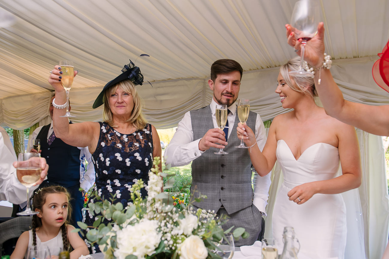 Bride, groom and family toasting during speeches at Russets Country House