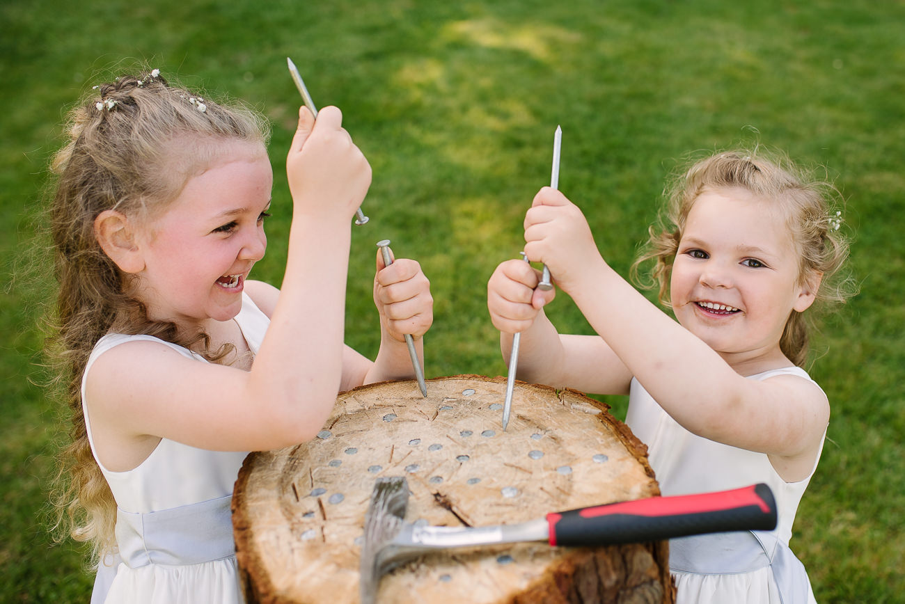 Cheeky flower girls playing with long nails, pretending to play stump