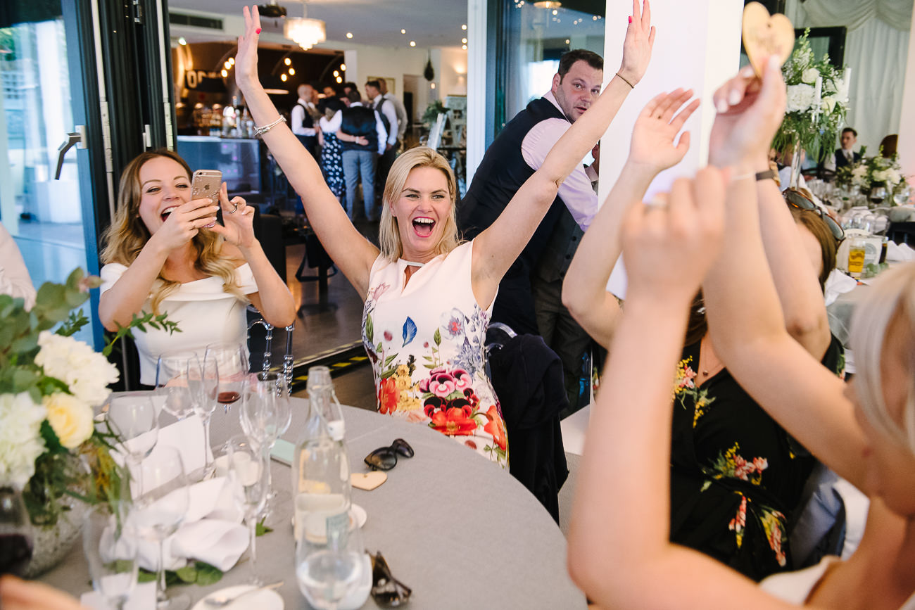 Wedding guests cheering and laughing at Russets Country House reception