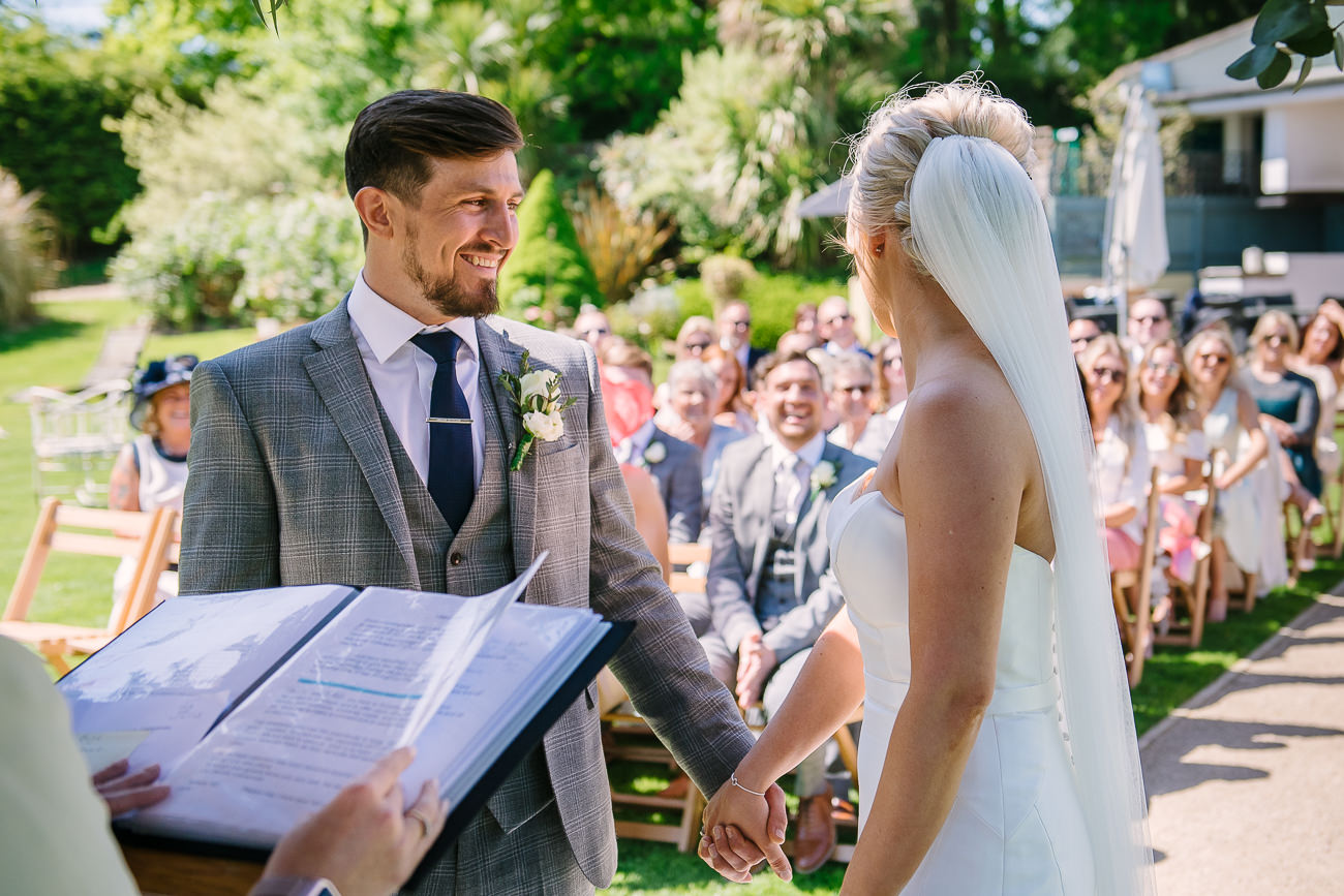 Groom takes bride's hand and smiles at Russets Country House