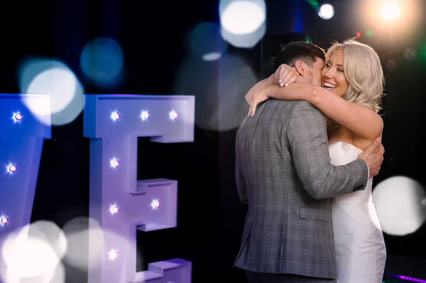 Bride and groom dancing on the dance floor in a tight embrace