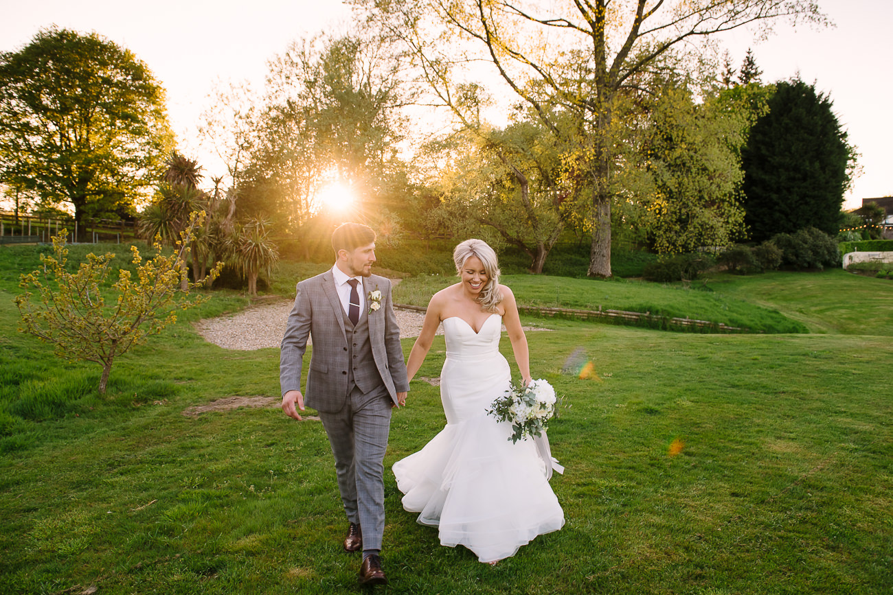 Bride and groom posing in the sunset at Russets Country House
