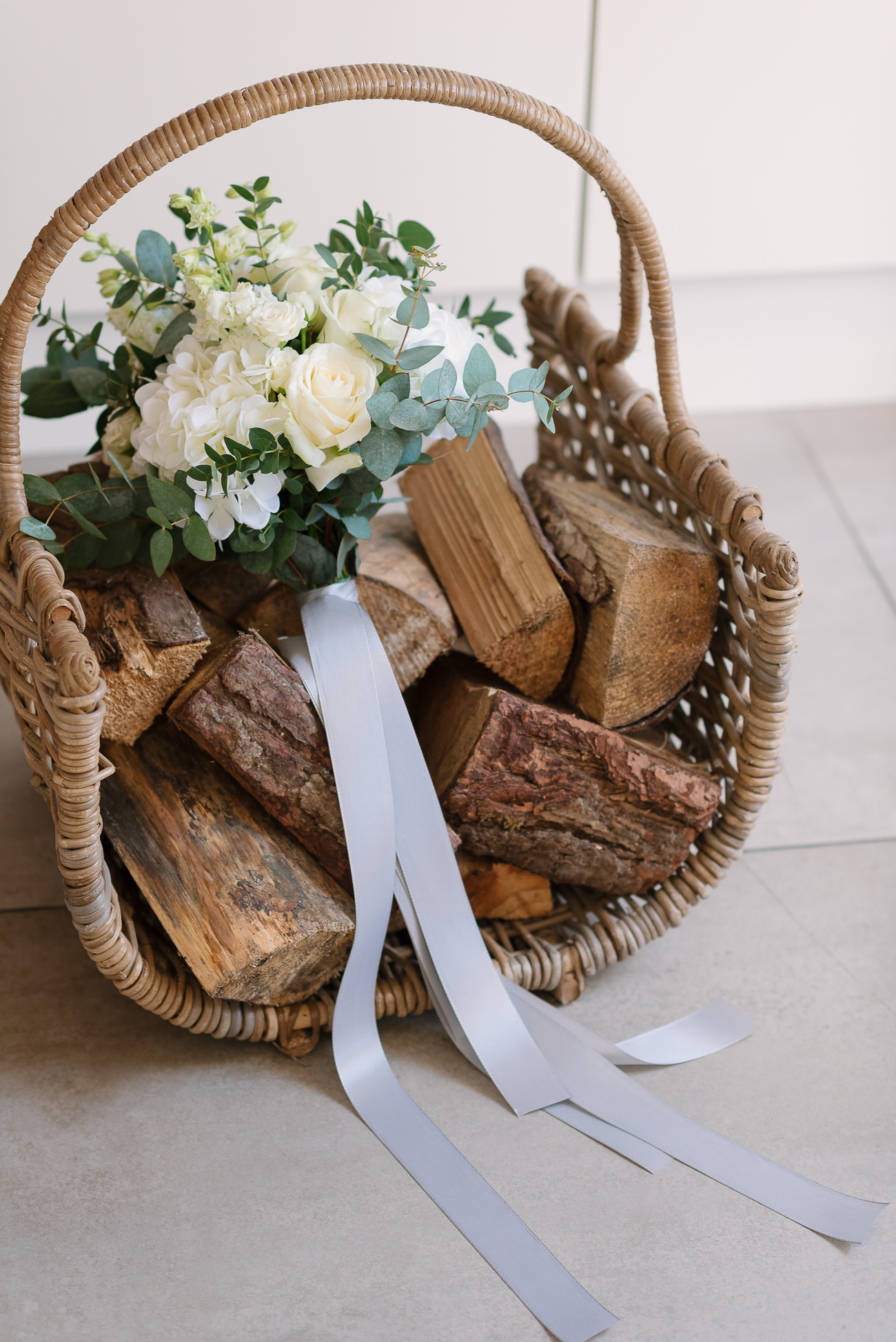 Lovely bouquet white flowers on logs tight with a silver ribbon