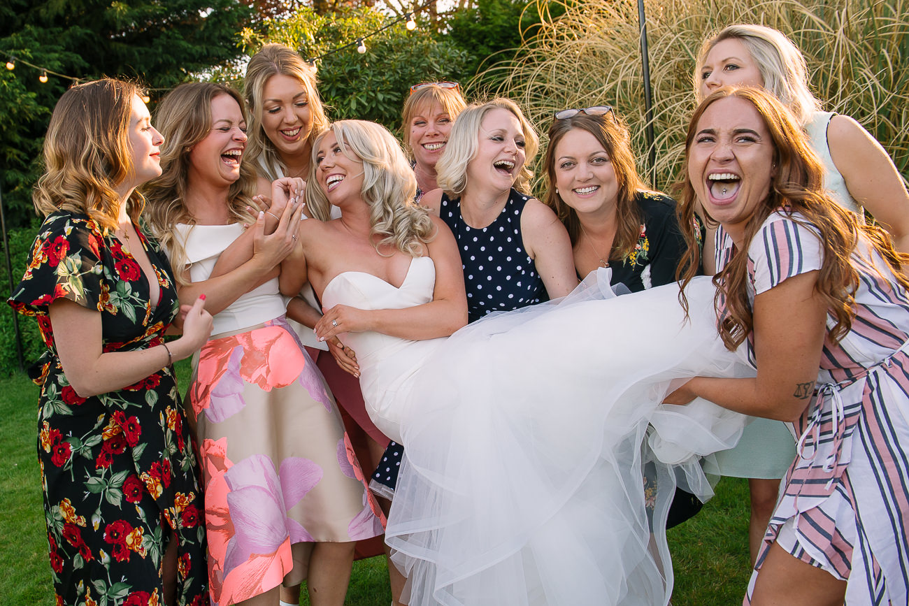 Girls lifting the bride in fish pose at Russets Country House