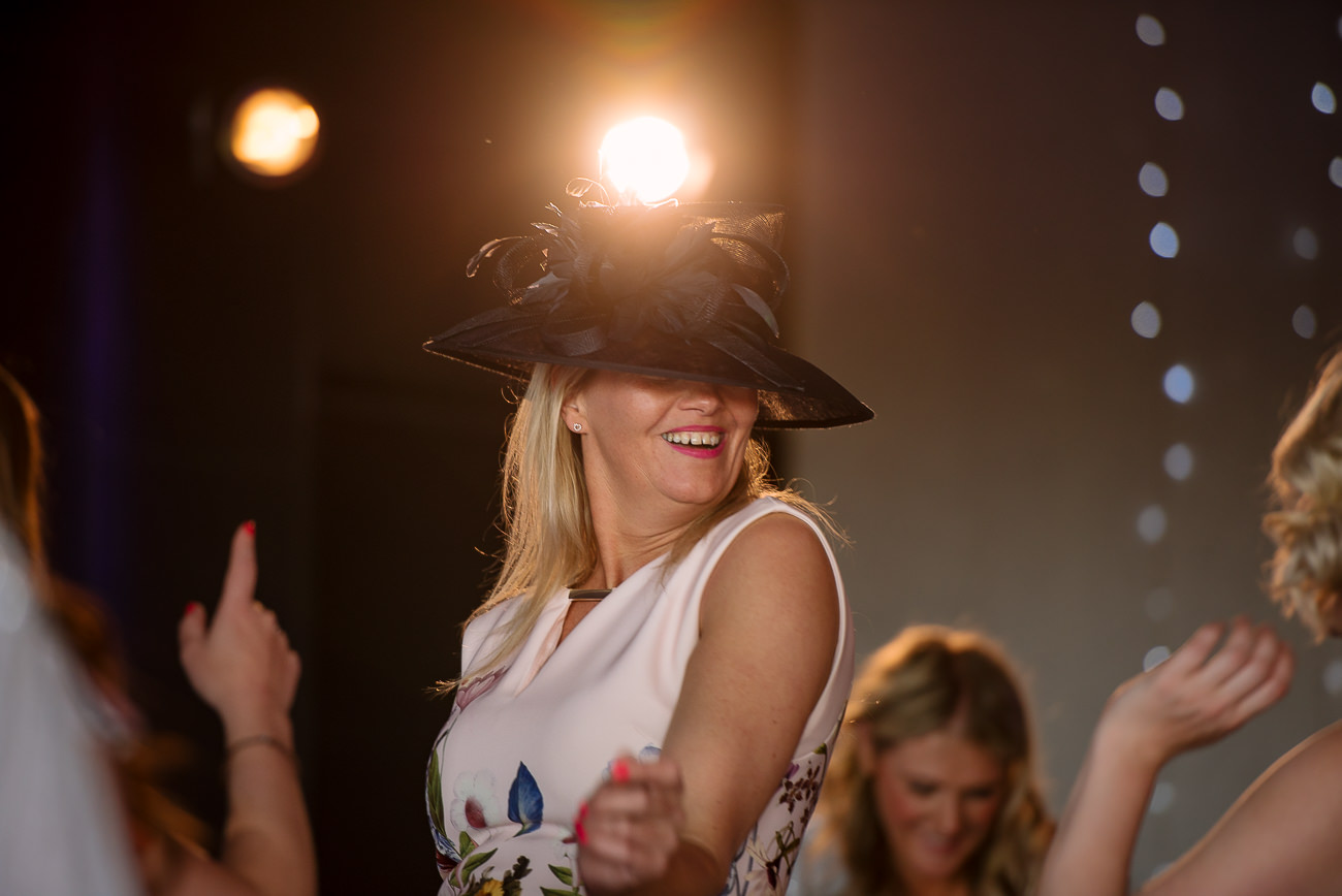 Woman with black hat dancing