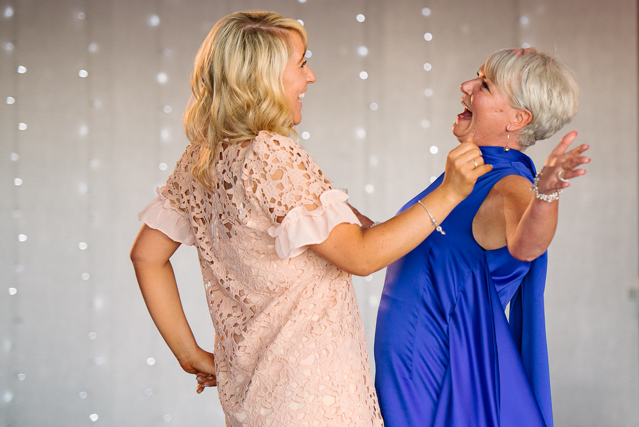 Two ladies dancing and having fun on the dance floor at Russets