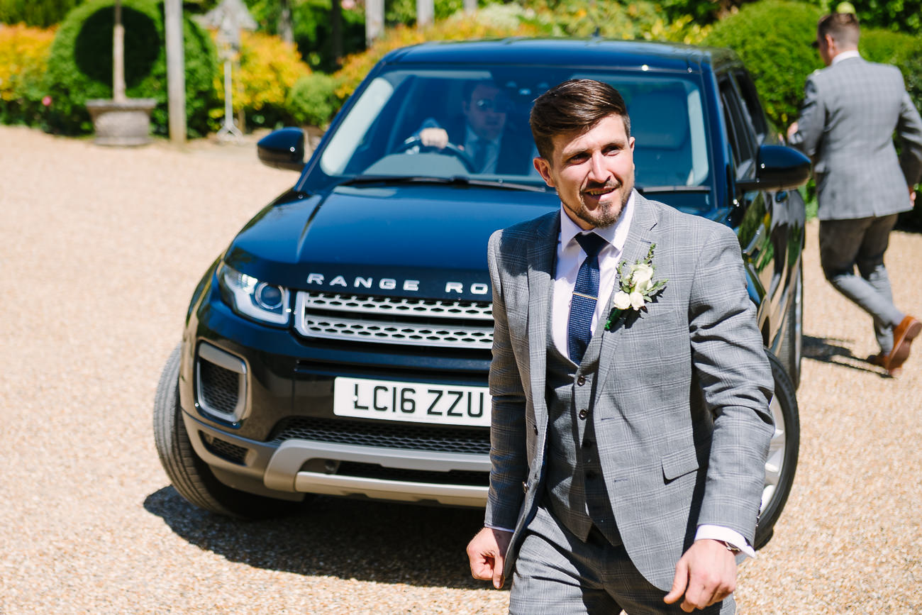 Groom arriving at ceremony with a black car