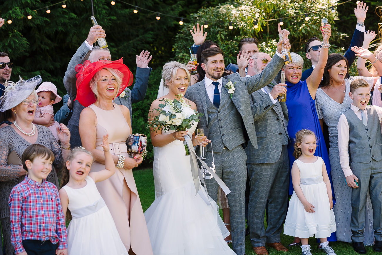 Family group photograph with bride and groom in the middle