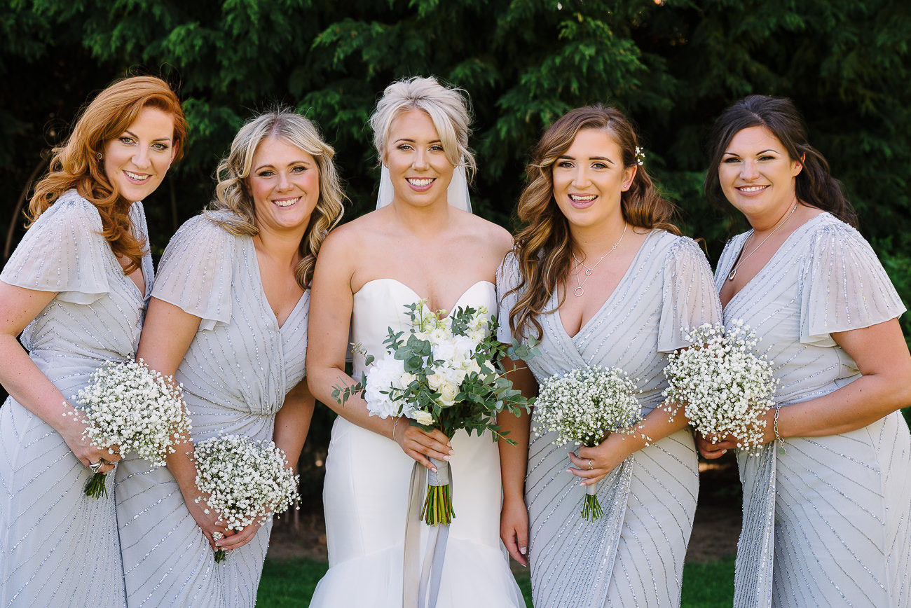 Bridesmaids and bride group photograph at Russets Country House