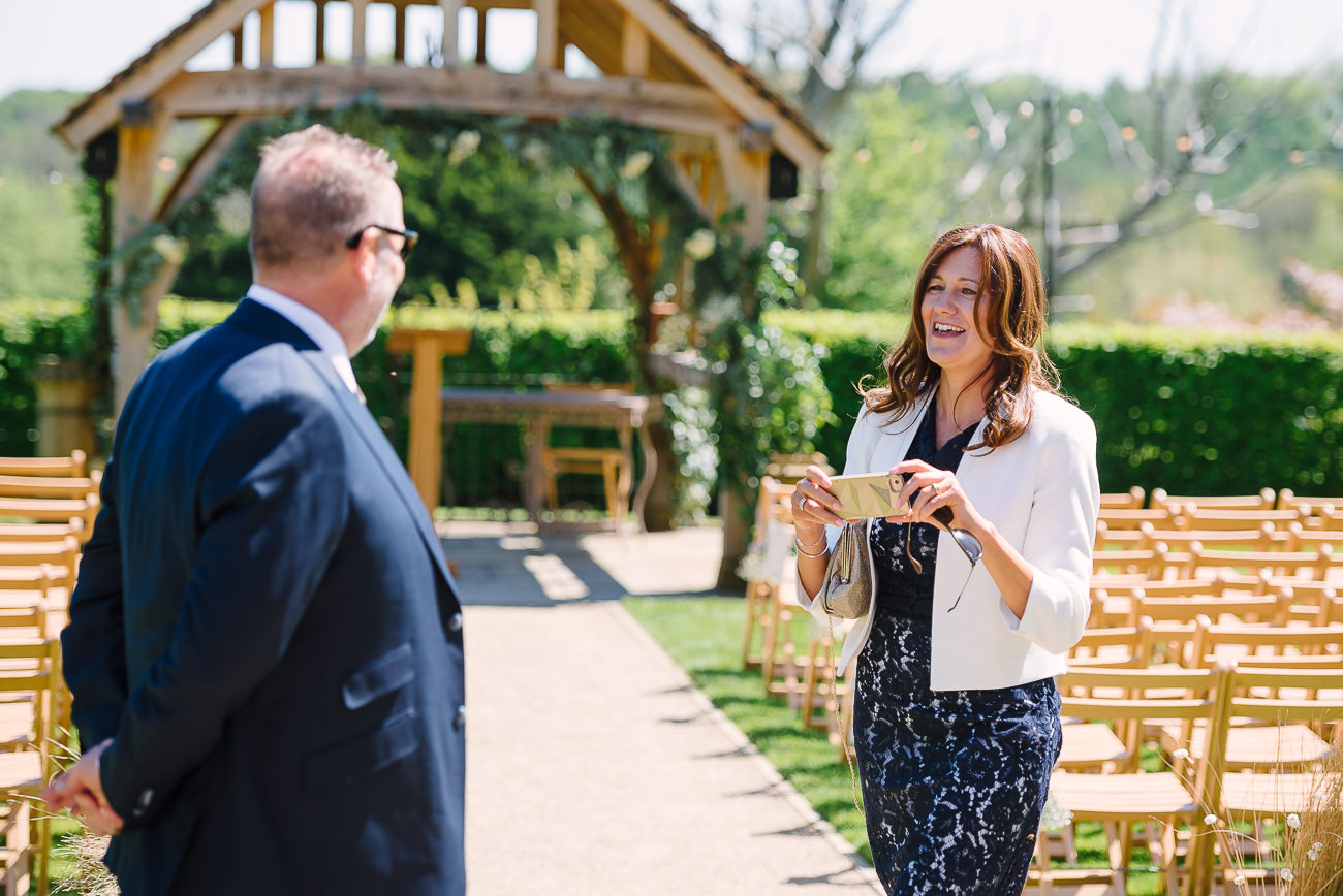 Mother of the groom taking photos at Russets wedding venue