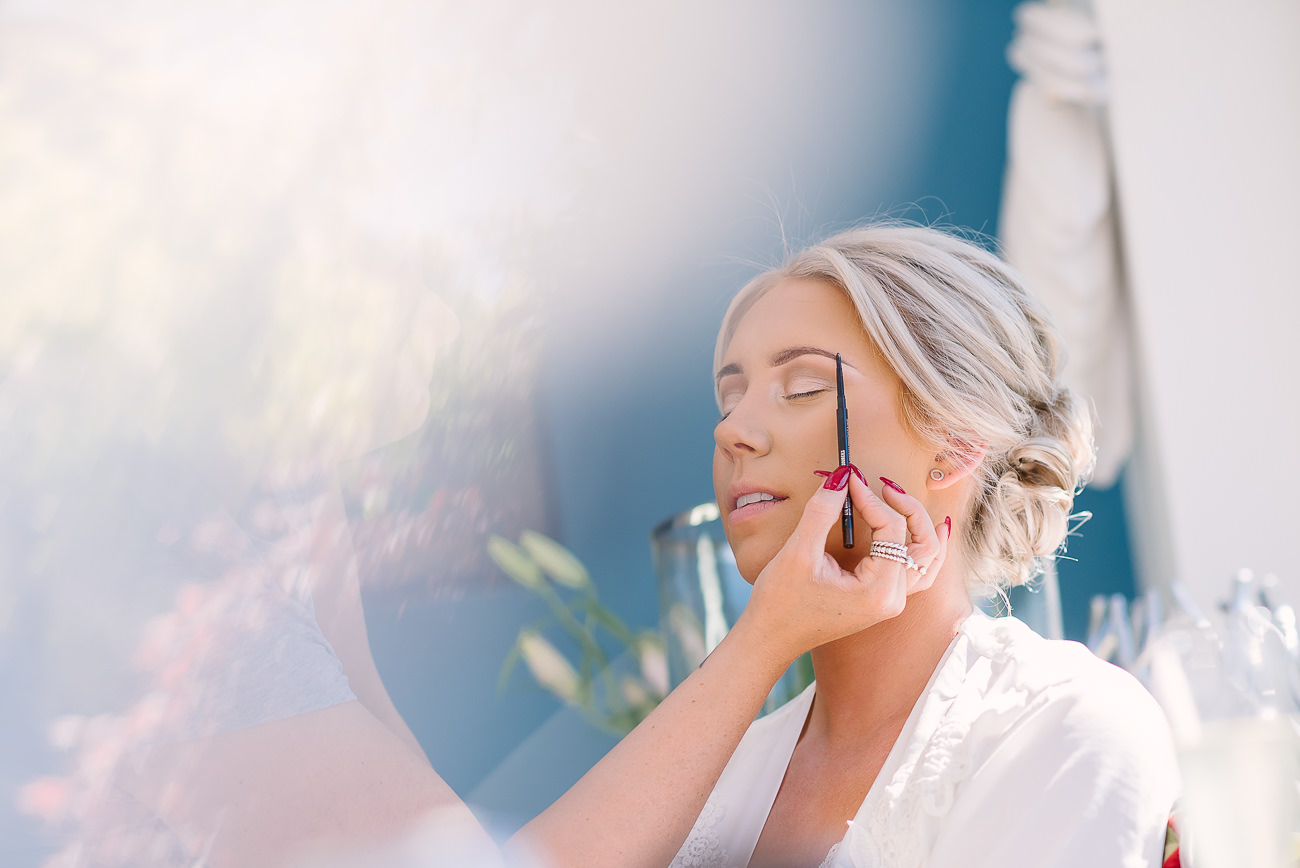 Bride having her make-up done at preps