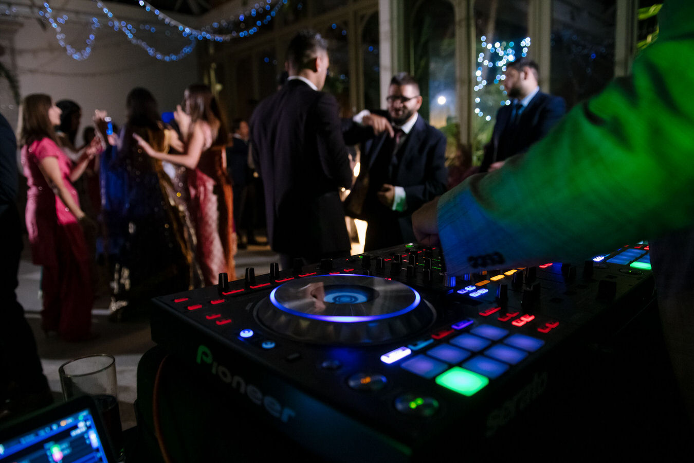 Sikh Asian wedding Dj mixes the music for the party so everyone enjoys himself