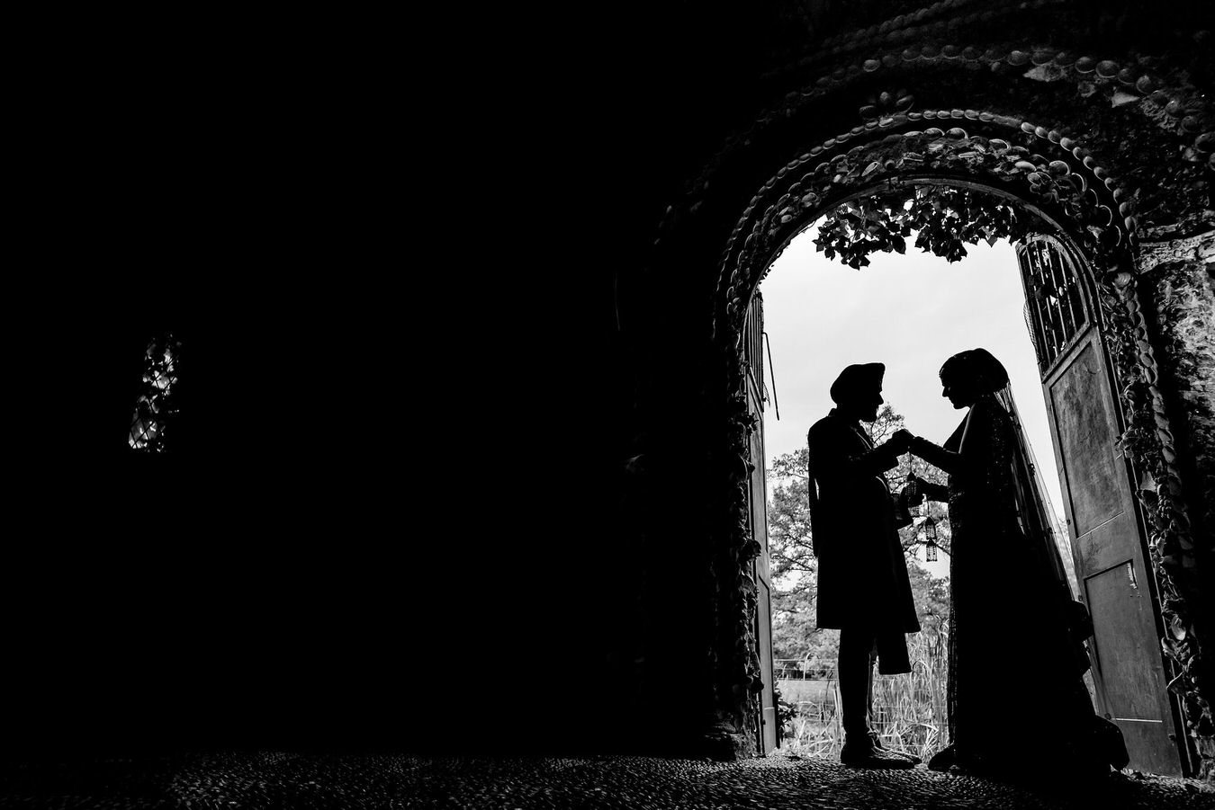 Black and white silhouette photography of bride and groom at Hampton Court House